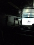 The movie theater inside the bus.