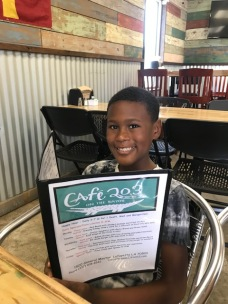 Cool menu with breakfast, salads, kids' food, wraps, and lunch plates too.