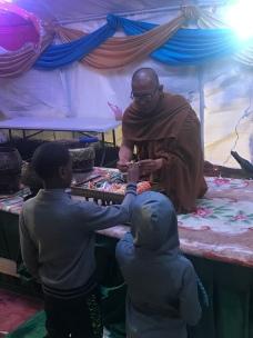 A monk giving us bracelets.